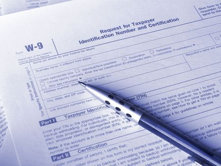 Tax form W-9 and pen photo