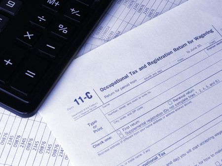 Tax form 11-C and calculator photo