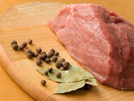 Fresh meat with black pepper and laurel leaves photo