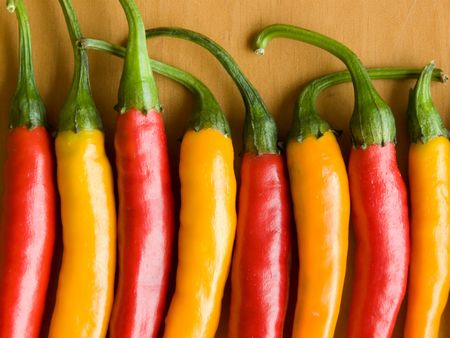 Row of the red and yellow chili peppers.