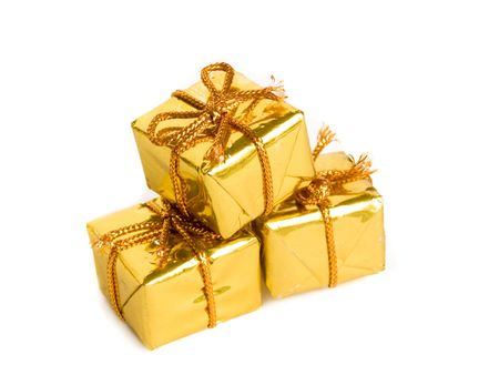 Three small golden gifts, isolated over white. Stock Photo - 5621137