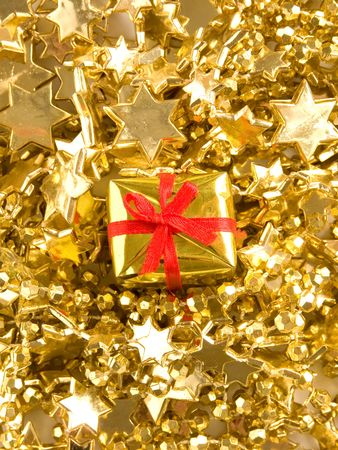 Small golden gift with red ribbon. Shallow DOF. photo