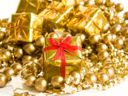 Small golden gift with red ribbon. Shallow DOF. Stock Photo - 5660041