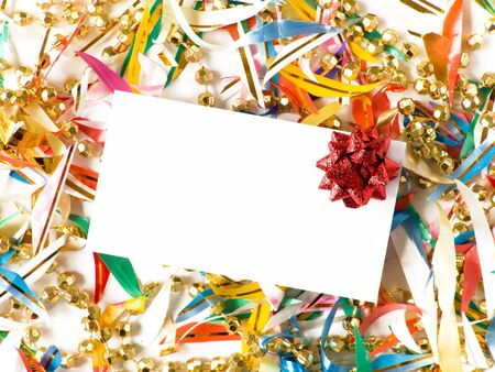 Blank gift card with red bow around colored confetti. Shallow DOF.