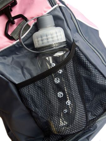 Closeup photo of the modern sport bag with drinking bottle. Shallow dof. photo