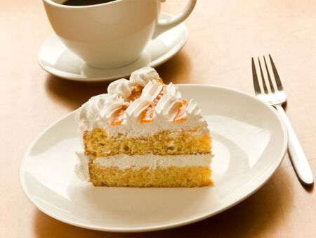 coffee jelly: Cup of coffee and tasty cream cake with apricots. Shallow dof. Stock Photo