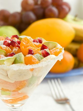 Glass with different kind of fruits. Shallow dof. photo