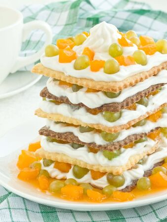 Stack of shortcakes with whipped cream and fruits. Shallow dof. photo