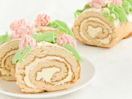 Plate with sweet homemade cream roll. Shallow dof. Stock Photo - 6405641