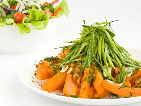 Plate with warm pumpkin salad on white. Shallow dof. Stock Photo - 6593663
