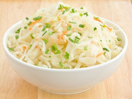 A white bowl with traditional ukrainian sauerkraut.