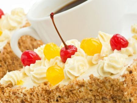 Homemade biscuit cream cake and coffee cup. Shallow dof. photo