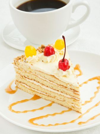 Plate with piece of cream cake and coffee cup. Shallow dof. Stock Photo - 6688422