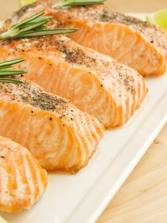 Plate with backed salmon steaks. Shallow dof. photo