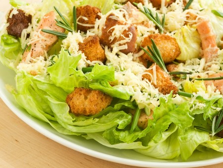 caesar salad: Plate with fresh caesar salad. Shallow dof.