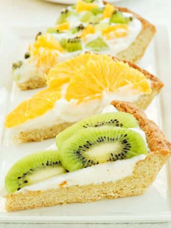 Plate with three homemade fruit-tart slices. Shallow dof. photo