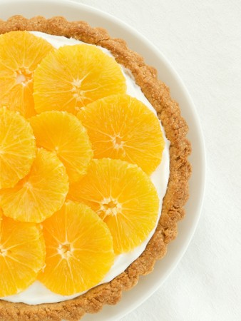 orange tart: Plate with homemade orange tart, viewed from above.