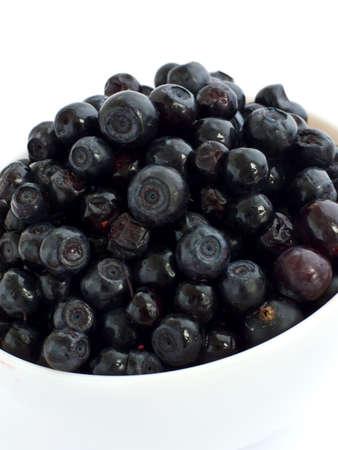 bilberries: White bowl with sweet bilberries. Shallow dof. Stock Photo