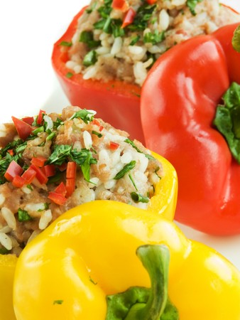 Plate with baked stuffed peppers. Shallow dof. Stock Photo
