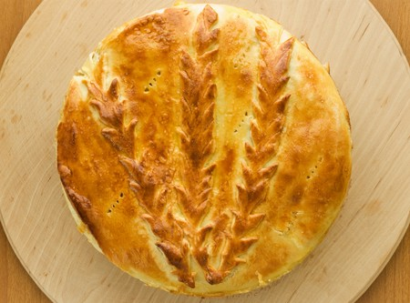 Fresh-baked traditional ukrainian homemade cabbage pie. Viewed from above. photo