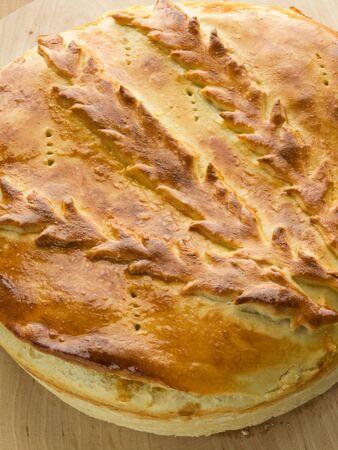 Fresh-baked traditional ukrainian homemade cabbage pie. Shallow dof. photo