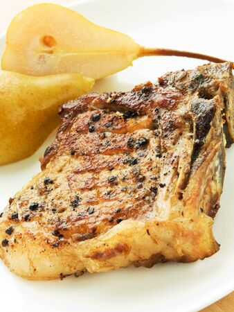 Grilled pork steak with pears. Shallow dof. photo
