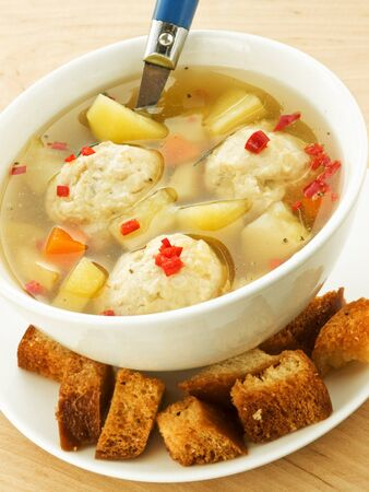 Soup with chicken meatballs and croutons. Shallow dof. photo