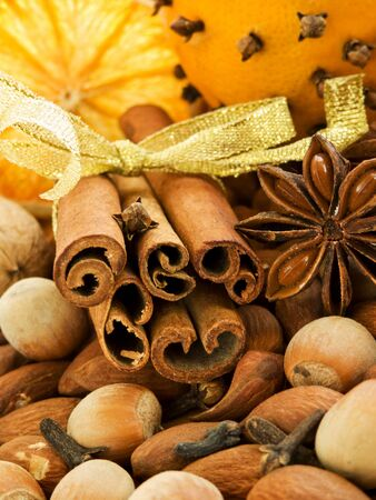 clove: Different kinds of nuts, spices and dried oranges. Shallow dof.