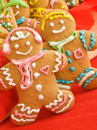 gingerbread man: Homemade gingerbread cookies with colored glaze. Shallow dof.