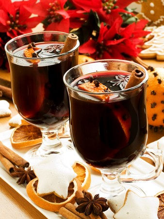 Mulled wine with slice of orange and spices. Shallow dof. Stock Photo