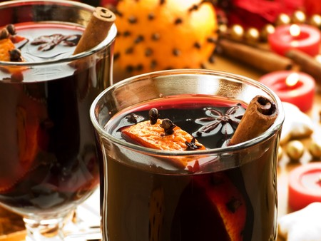 mulled: Mulled wine with slice of orange and spices. Shallow dof. Stock Photo