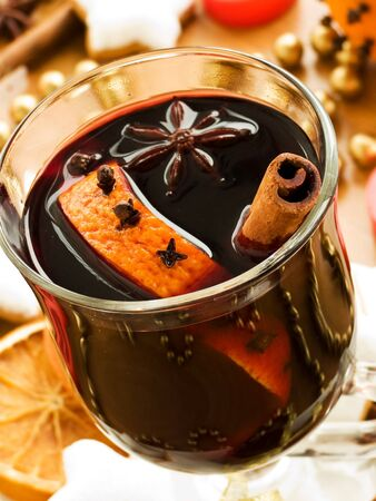 Mulled wine with slice of orange and spices. Shallow dof. photo