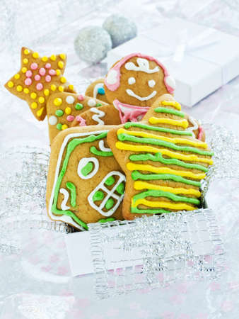 Homemade gingerbread cookies with colored glaze in box. Shallow dof. photo