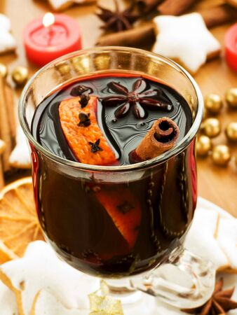 mulled wine: Mulled wine with slice of orange and spices. Shallow dof. Stock Photo