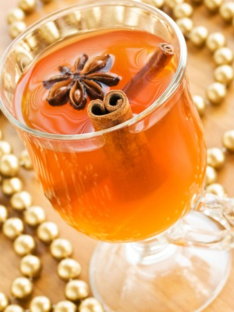 Glass of hot toddy with cinnamon and anise. Shallow dof. photo