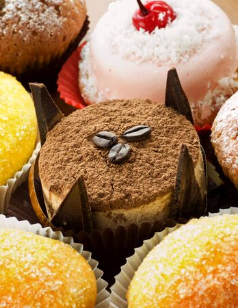 Different kinds of cakes and desserts. Shallow dof. photo