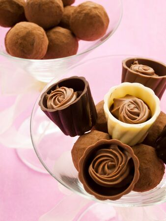 Chocolate truffles and pralines for Valentines Day. Shallow dof. photo
