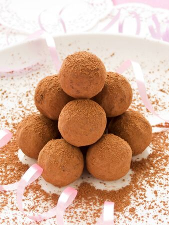 chocolate truffle: Chocolate truffles for Valentines Day. Shallow dof. Stock Photo