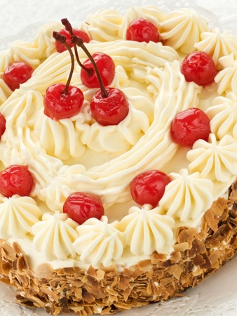 Delicious homemade cake with butter cream and cherries. Shallow dof.