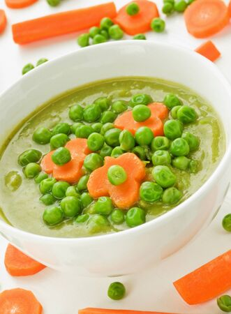 Green pea soup with carrot. Shallow dof. Stock Photo