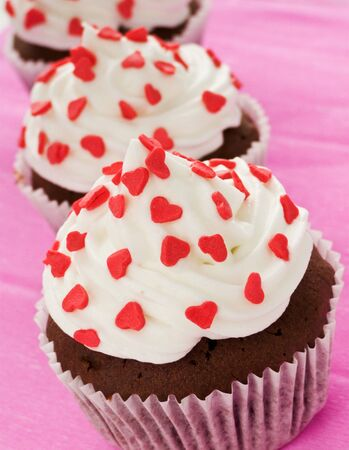 Chocolate cupcakes for Valentines Day. Shallow dof. photo
