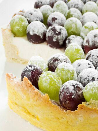 powdered sugar: Cheesecake with grapes and powdered sugar. Shallow dof. Stock Photo