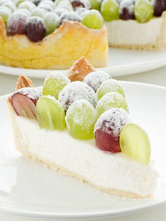 Slice of grape cheesecake with powdered sugar. Shallow dof. photo