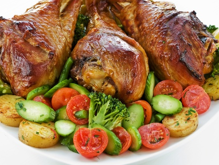 Roasted turkey legs with vegetables. Shallow dof. photo