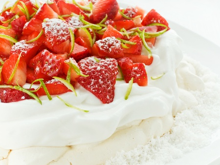 Plate with delicious strawberry Pavlova dessert. Shallow dof. photo