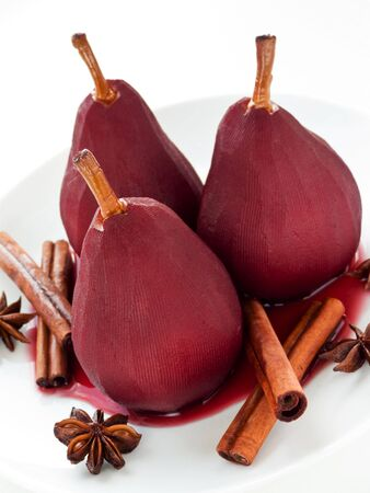 poached: Poached pears in red wine with spices. Shallow dof.