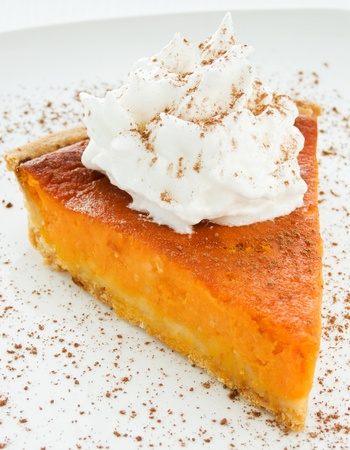Homemade pumpkin pie with whipped cream. Shallow dof.