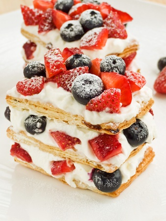 mille: Strawberry-blueberry mille feuille with whipped sour cream. Shallow dof.
