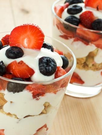 parfait: Glasses with strawberry-blueberry parfait. Shallow dof. Stock Photo