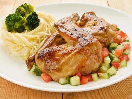 Plate with roasted rabbit legs and vegetable garnish. Shallow dof. Stock Photo - 9749703
